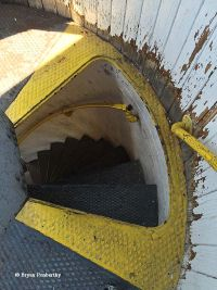 Hatch leading to stairs inside the Fort Niagara Lighthouse.