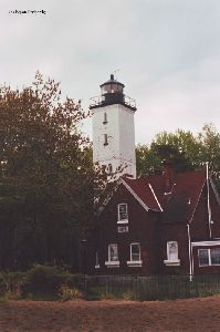 The lighthouse and the quarters.