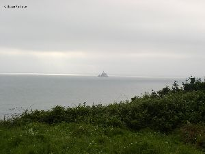 The lighthouse sits several miles off shore.